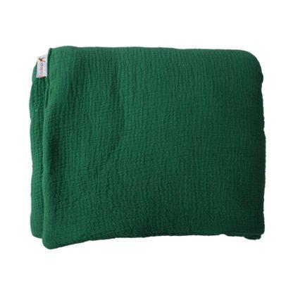 couverture pliée verte