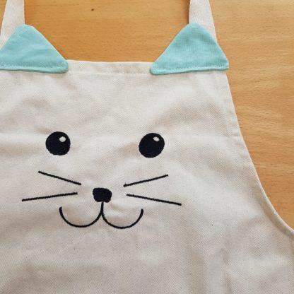 Tablier tete de chat en coton fabrication fairtrade artisanal