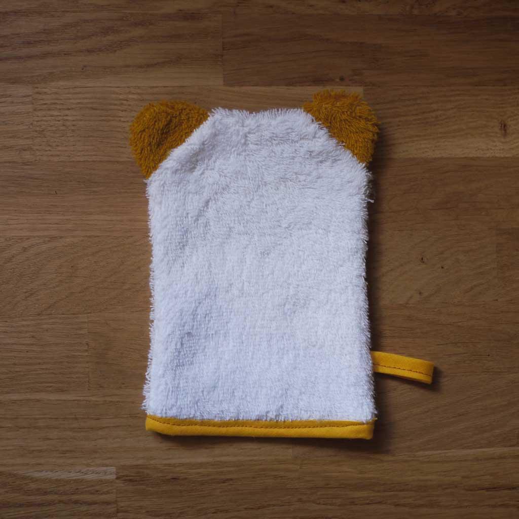 dos du gant de toilette chat jaune
